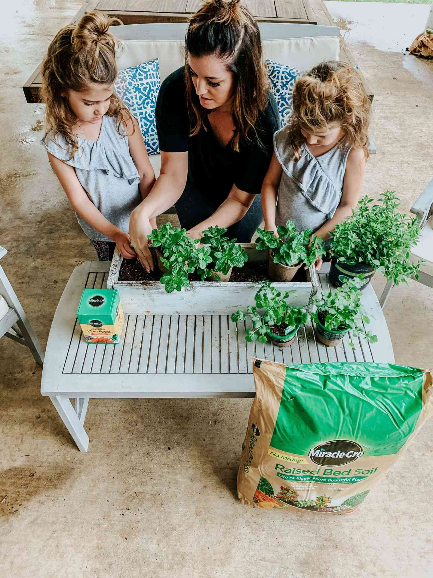 gardening tips for gardening with kids, planting an herb garden, garden with kids, raised bed gardening, miracle gro
