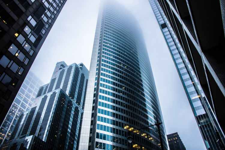 gray high rise buildings - 8 Advantages of Trading Forex That Will Motivate You to Get Started