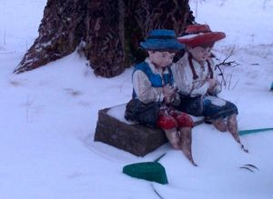 Two little figures in the snow