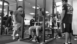 RENOVATED SPACE: Left, a student works out with new weights.