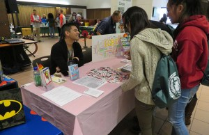Students get information at a booth during the Road to Independence event. PHOTO BY CATLAN NGUYEN