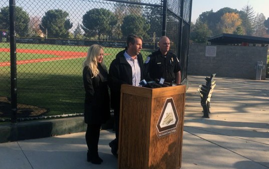 Sean Riley speaks to the crowd at a news conference regarding multiple rewards being offered for information about the death of his son, Delta College baseball player Calvin Riley.