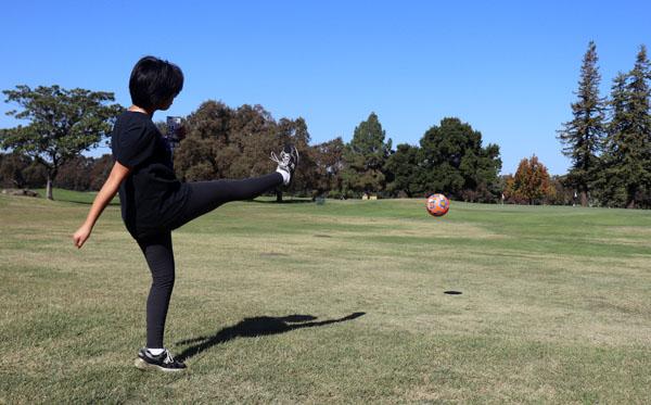 Opinion Editor Vivienne Aguilar kicks the ball down the fairway.