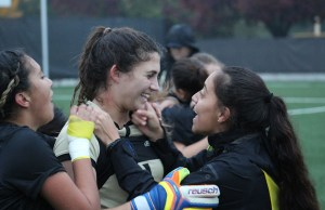 Goalie Amanda Leal celebrates with teammates