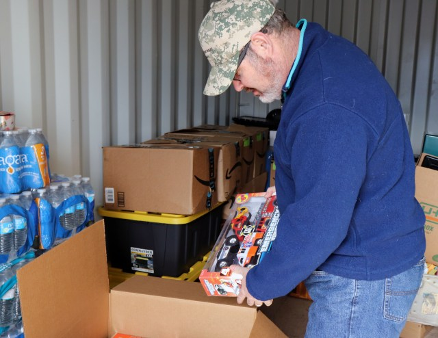 John Wolfe in the storage conatiner where all of the donations are being held. Donations include toys, school supplies, water bottles, and more. Photo by Catlan Nguyen