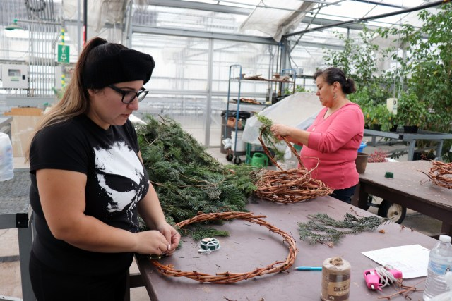 Kimberly Valdez and Mirna Juarez finishing wreaths on Nov. 28 for the fundraiser.