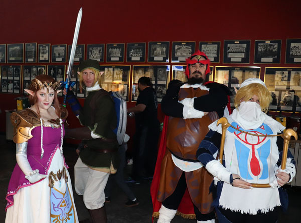 """(Left to Right) Heather Thompson, Robert Chapman, Dan Hanes and Sarah Johnson are dressed as characters from """"The Legend of Zelda"""" for the first winter StocktonCon Thompson is dressed as Princess Zelda, Chapman as Link, Hanes as Ganondorf and Johnson as Sheik. Photo by Jasmine Gonzalez."""