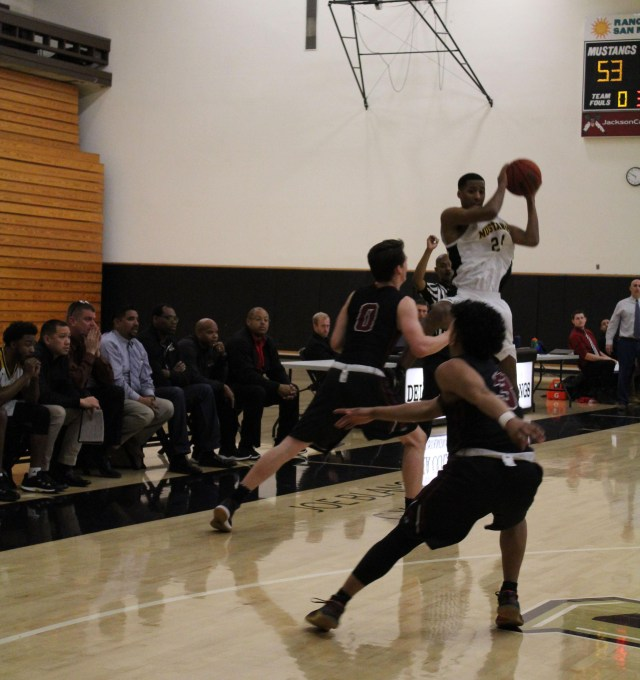 Delta Mustang's Montiero Spencer, no. 24, looks to pass to an open teammate. The game took place in the Tony Marcopoulos Gym at Delta College. Photo by Vivienne Aguilar