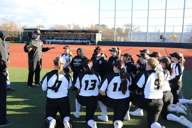 Head Coach Jim Fisher talks to his team after a season opening win against West Valley. Photo by Paul Muyskens