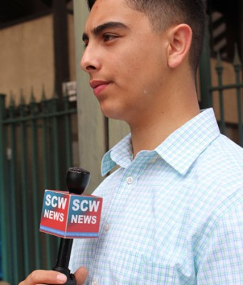 High school jounalist Gabe Porras reports at the Stockton Slut Walk on his channel SCW News. Photos by Ayaana Williams.