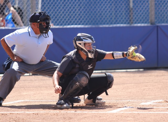 Janelle Rodriguez catches a pitch during the final game of the season