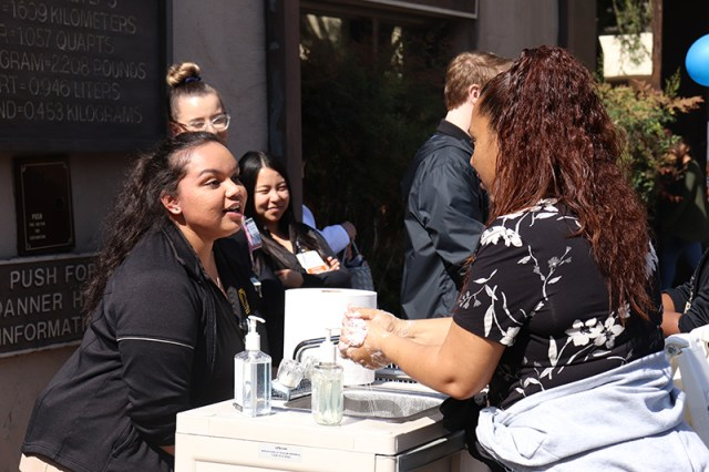 Student nurse Riddhi Patel gives a handwashing demonstration in the quad. PHOTO BY HANNAH WORKMAN