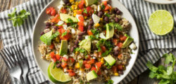vegetarian burrito bowl with rice, avocado and salsa