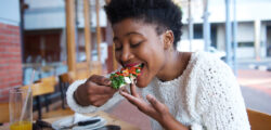 woman eating a vegetarian pizza