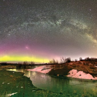 Qiuryiit/Agyat in Bethel The Milky Way fills the night sky as the aurora borealis or qiuryiit glows in the distance from a secluded spot in the outskirts of Bethel.