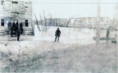 The Grist Mill was built in 1837 on the north bank of the Grand River, near the corner of Vermont Street and Main Street. This picture of the Grist Mill was taken in the spring of 1904 after a flood. The mill was torn down later that year in August of 1904. In the background is the Delta Mills Bridge. In the foreground you can see the water which had risen over the banks of the Grand River, past the Grist Mill and up to where L.D. Wilson stands alone. Wilson married Lela Ann Ingersoll, who was the great granddaughter of Erastus Ingersoll the first settler of Delta Township.