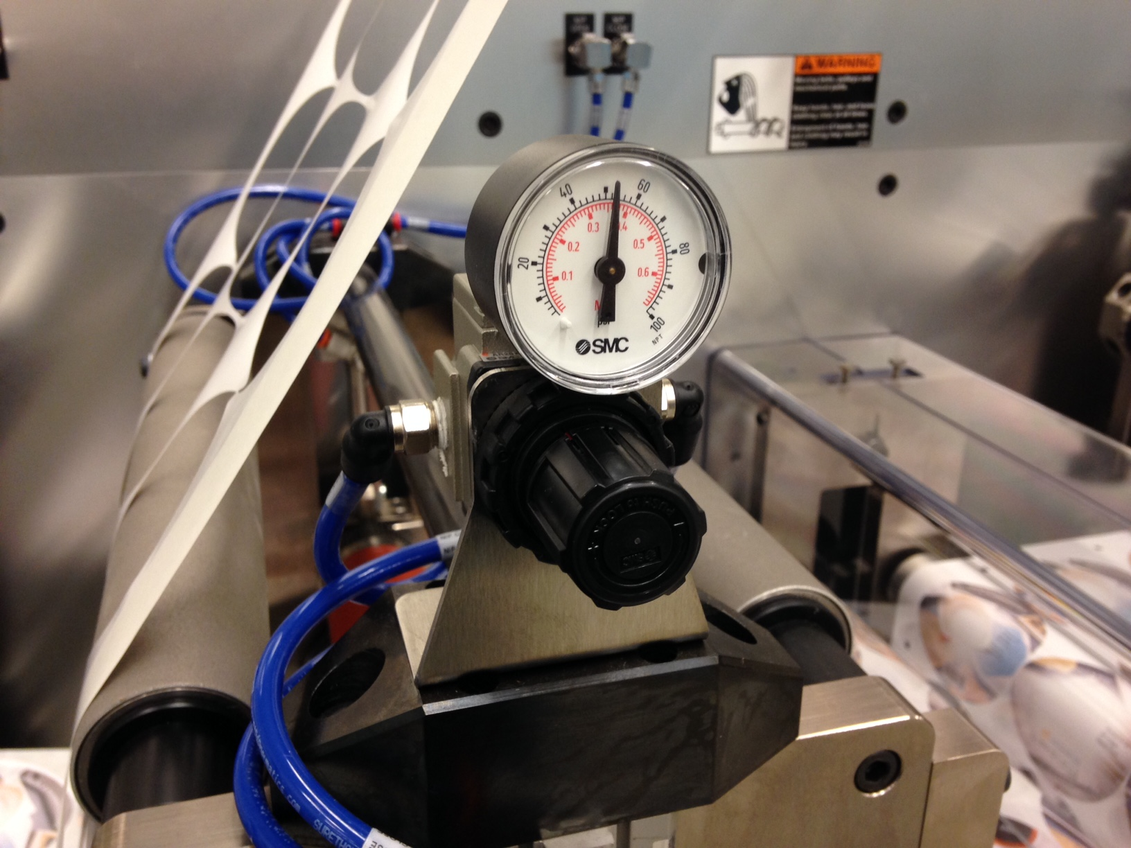 Nip station pneumatic pressure adjustment