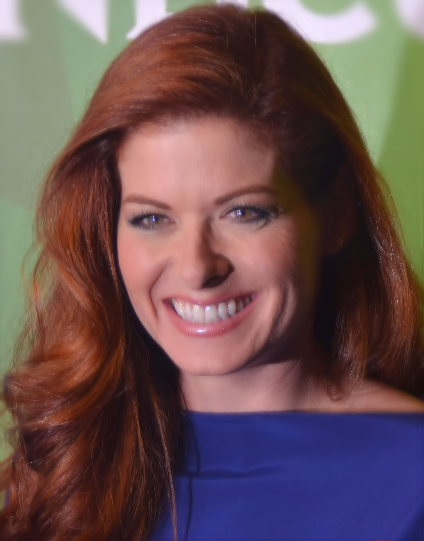 Debra_Messing_July_13_2014_cropped_and_lighting_corrected