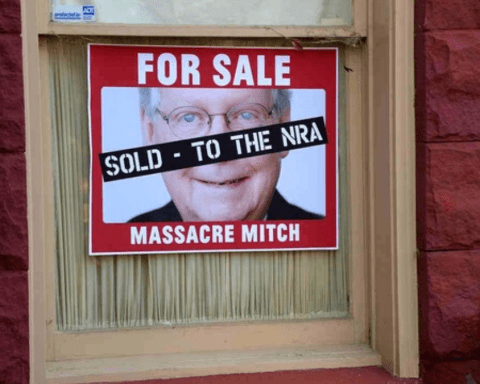 Sign in Window: For Sale: Massacre Mitch. Sold to the NRA.