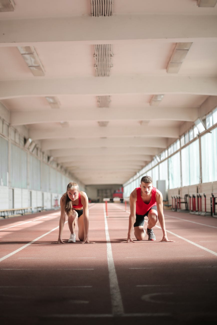 young athletes preparing for running in training hall