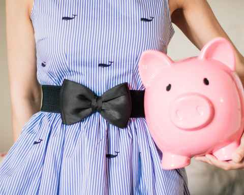 lady in stripped dress with piggy bank