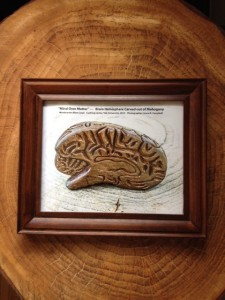 Picture of framed image of wood carved brain hemisphere - with caption