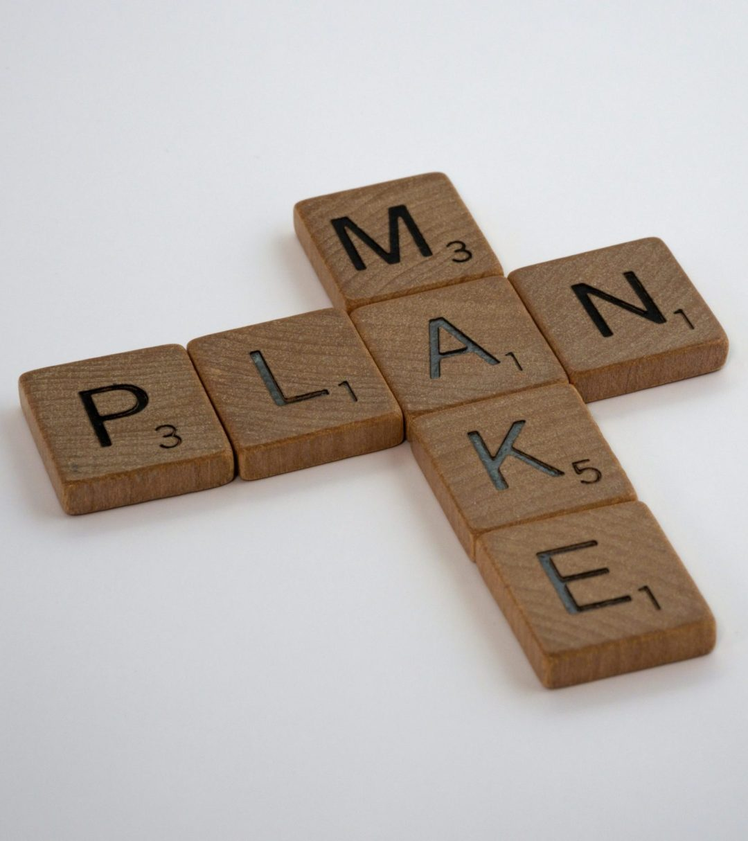 """Scrabble letters spelling the words """"Make"""" and """"Plan"""""""