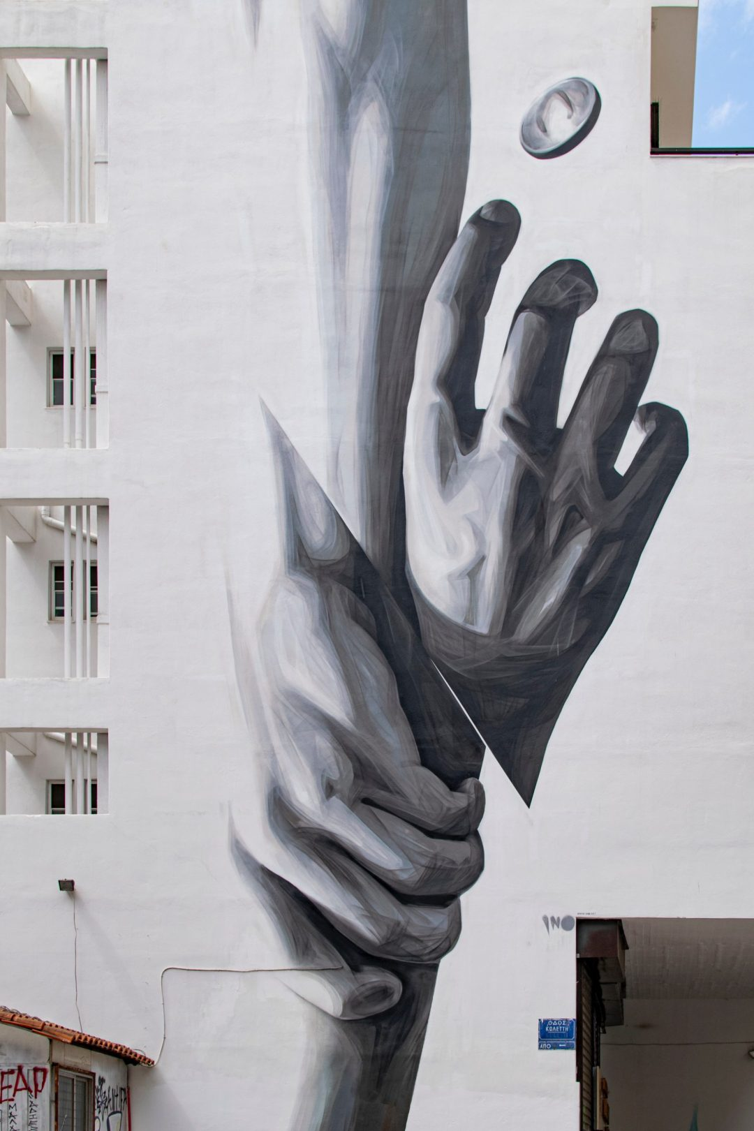 Painting of one hand grasping another's wrist