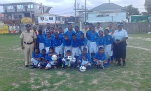 'F' Division Commander,Senior Superintendent Ravindradat Budhram and members of the Kaleidoscope Football Club in Bartica.