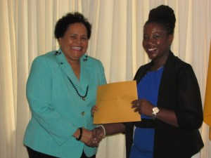Artistes In Direct Support Coordinator Desiree Edghill receives support for her organsations' programmes from CSR Manager Ayaana Jean-Baptiste