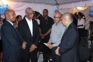 Left to right: Eureka Medical Laboratories' CEO, Andrew Boyle; President David Granger; Dr. David Singh of the Ministry of Natural Resources and Minister of Public Health, Dr. George Norton chatting after the formal commissioning of the lab's fully-solar powered building.