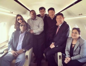 Minister of State, Joseph Harmon (seated left), Chairman of the Guyana Civil Aviation Larry London (standing second from left) and top officials of Baishan Lin in an aircraft in China. Seated (at extreme right) is a Guyana government official.