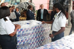 Commissioner General of the Guyana Revenue Authority (GRA) Godfrey Statia overlooking a cargo examination by Customs Officers at the Demerara Shipping Company Limited