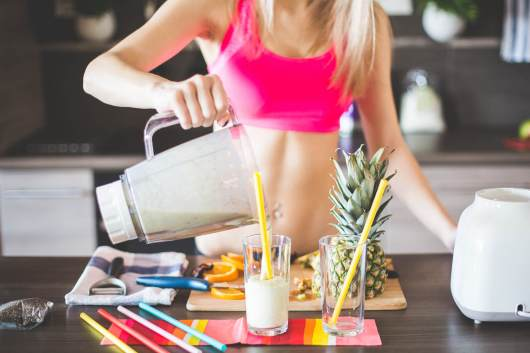 fitness-girl-preparing-healthy-smoothie-picjumbo-com