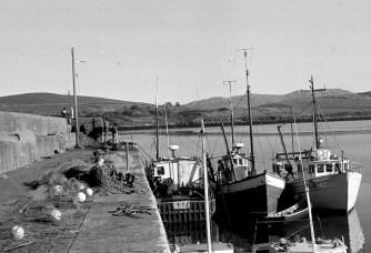 Cleggan fishing boats at the pier by Bill