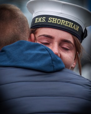 SCOTS-BASED ROYAL NAVY MINE HUNTER SETS SAIL FOR GULF DEPLOYMENT A tearful goodbye to the family and friends on the jetty. SCOTS-based Royal Navy mine hunter HMS Shoreham left her home port at HM Naval Base Clyde today (June 18) to embark on a 6,000 mile journey to the Gulf region. The 40 men and women on board the Sandown Class Mine Counter Measures Vessel (known as an MCMV) waved farewell to friends and families as they set sail from the Argyll and Bute Base to take over from sister-ship HMS Bangor who has spent the past three-years in the Middle East. Sailing the ship was Crew 3 from the First Mine Counter Measures Squadron (MCM1), the Faslane-based force which forms part of the UK's dedicated Mine Warfare Battle Staff.