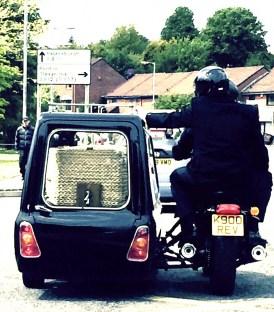 Coffin in motor bike hearse