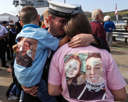 HMS Bangor Returns Pictured here Let ME Brian Peacock with son Arron and daughter Aleshia HMS Bangor, one of the Royal Navy's seven Sandown-class mine countermeasures ships, has left Bahrain after three years of Middle East heat and returned back to her home in Faslane, Scotland. Families lined the jetty to welcome the Faslane based MCMV home after three years in Bahrain. Over the past three years the ships have surveyed across the Gulf, visited 15 different countries, entertained countless VIPs and once in their home ports, will have travelled more than 40,000 nautical miles each. *** Local Caption *** consent held