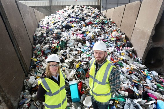 Auchencarroch Recycling Centre PIC SHOWS Cllr Marie McNair and Cllr Iain McLaren with the plastic taken from black bag collections