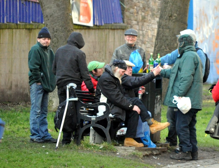 Rough sleepers gather for a drinking session on the Meadows in Edinburgh