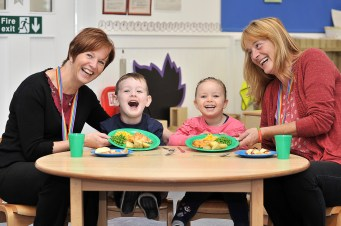 Three year old Ethan Rankin and Lola KIDS Farren show an example of a hot meal they'll be getting under the new expanded scheme