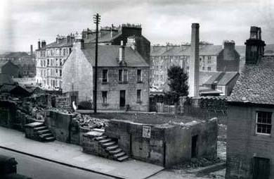 Dennystown with Levenhaugh Street, the large tenement on the left.