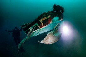 HMS Royal Oak, Royal Navy divers recovering an ensign from the wreck to fly a new ensign for the 79th anniversary.
