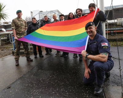 Purple Friday LGBT Flag Raising The RN Compass organisation has obtained permission from NBC Clyde and CO 43 CDO to fly the LGBT rainbow flag from 43 CDO's flag pole to mark LGBT history month. The LGBT Youtgh Scotland event where organisations fly the rainbow flag to show support. The flag was raised and flown in the presence of sailors, Royal Marines and MOD civilians.