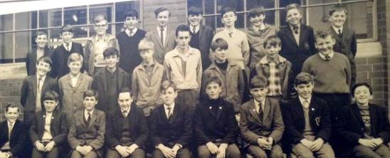Robert Corker, photographer, fourth from right back row, Johnny Briggs, extreme right front row, DavieGrubb, the Carpet Man from the Co-op, fourth from left front row, Robert Watt, John Stewart, Peter McKenzie, Tommy and James Malcolm at Hartfield School in Dumbarton in the Seventies.