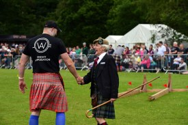 """Free pictures on behalf of West Dunbartonshire council. 2019 Loch Lomond Highland games at the Moss O' Balloch. A record number of visitors turned out to watch the popular annual Loch Lomond Highland Games at Balloch today. More than 9,000 visitors attended the event, in Moss O'Balloch Park, for a range of traditional highland game competitions including cycling, running, hammer throwing and heavy weights and the traditional tossing of the caber and tug-of-war. Dancers entertained the crowds by performing traditional highland dances with their immaculate costumes and perfect hair, and spectators enjoyed music from Helensburgh Clan Colquhoun and Tulliallan pipes and drums. The popular games welcomed visitors from as far afield as Germany and Canada who travelled to Scotland to enjoy the traditional Scottish games and was broadcasted to millions of viewers in China watching Chinese travel programme 'Zhu's life in Britain'. Aynsley Gouck, Assistant Director of Niagra Highland Dance Academy, said """"We are over from Ontario Canada and we are attending four Highland Games during our visit. We love Balloch it's a beautiful area of Scotland and we've been looking forward to our visit. The Highland Dancing competition is very well organised and the girls are very honoured to be dancing in Scotland."""" German friends Tina and Arthur Helbig and Kirsten and Volber Rademacher, said: """"We are in Scotland for 10 days and although we're not staying in Balloch we couldn't miss this event. It's a great to see all the smart girls in their beautiful Highland dress and hear the pipe band. We are very excited to be here today."""" West Dunbartonshire Council leader Jonathan McColl, said: """"This year's event was a fantastic day and helped by the wonderful weather. Well done to all the competitors for putting on a great show and thanks to the spectators for encouraging the athletes and putting on a great show. It's always lovely to meet visitors who have"""