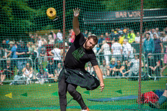 """Free pictures on behalf of West Dunbartonshire council. 2019 Loch Lomond Highland games at the Moss O' Balloch. A record number of visitors turned out to watch the popular annual Loch Lomond Highland Games at Balloch today. More than 9,000 visitors attended the event, in Moss O'Balloch Park, for a range of traditional highland game competitions including cycling, running, hammer throwing and heavy weights and the traditional tossing of the caber and tug-of-war. Dancers entertained the crowds by performing traditional highland dances with their immaculate costumes and perfect hair, and spectators enjoyed music from Helensburgh Clan Colquhoun and Tulliallan pipes and drums. The popular games welcomed visitors from as far afield as Germany and Canada who travelled to Scotland to enjoy the traditional Scottish games and was broadcasted to millions of viewers in China watching Chinese travel programme 'Zhu's life in Britain'. Aynsley Gouck, Assistant Director of Niagra Highland Dance Academy, said """"We are over from Ontario Canada and we are attending four Highland Games during our visit. We love Balloch it's a beautiful area of Scotland and we've been looking forward to our visit. The Highland Dancing competition is very well organised and the girls are very honoured to be dancing in Scotland."""" German friends Tina and Arthur Helbig and Kirsten and Volber Rademacher, said: """"We are in Scotland for 10 days and although we're not staying in Balloch we couldn't miss this event. It's a great to see all the smart girls in their beautiful Highland dress and hear the pipe band. We are very excited to be here today."""" West Dunbartonshire Council leader Jonathan McColl, said: """"This year's event was a fantastic day and helped by the wonderful weather. Well done to all the competitors for putting on a great show and thanks to the spectators for encouraging the athletes and putting on a great show. It's always lovely to meet visitors who have travelled around the world to attend this g"""