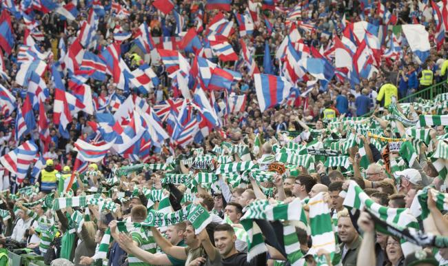 Sectarianism - segregated in football and in life, Celtic and Rangers fans at a recent football match between the clubs.