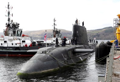 """HMS AUDACIOUS ARRIVES AT CLYDE HOME HMS Audacious, the fourth of the Royal Navy's Astute-class submarines, has arrived at her new home at HM Naval Base Clyde. The new submarine and her 98-strong crew arrived at the Naval Base in Argyll and Bute today (April 7), flying the White Ensign after sailing from BAE Systems in Barrow-in-Furness. Welcoming the vessel to her new home were members of the Submarine Flotilla – SUBFLOT – based at Clyde. """"It is with great excitement that we welcome HMS Audacious to the Clyde, joining her three sister submarines,"""" said Commodore Jim Perks OBE, Head of the Submarine Service. """"HMS Audacious represents an ever improving example of the world-leading Astute class submarine. She is right at the cutting-edge of technology, built here in the UK by our own people. She will provide the country with remarkable security at sea to protect our nation's interests."""" HMS Audacious will join sister-submarines HMS Astute, HMS Ambush and HMS Artful which are already in-service and operating from Faslane. A further three boats – named Anson, Agamemnon and Agincourt - are currently under construction at BAE in Barrow. The Astute-class vessels are among the most sophisticated submarines ever constructed for the RoyalNavy."""