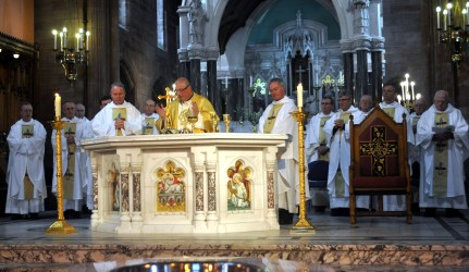 Dumbarton deanery priests concelebrate Mass in St Patrick's with Archbishop Tartaglia and Mgr Paul Conroy and his brother, Canon Gerry Conroy.